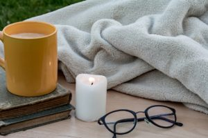 Candle, hot drink, glasses, blanket